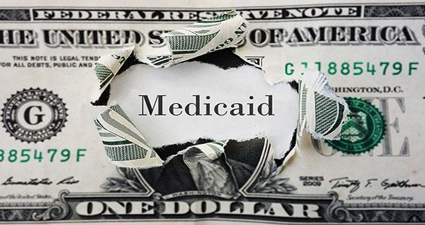Image of dollar bill and Medicaid