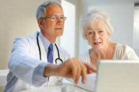 Doctor and patient at laptop