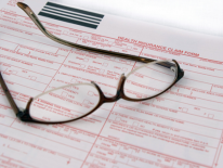 Glasses on a claim form