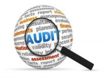 Magnifying Glass Over Audit
