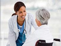 Medical worker attending patient in wheelchair